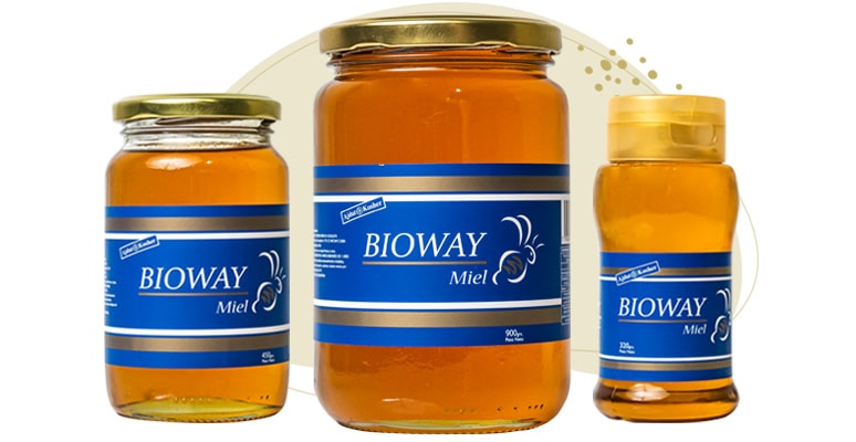 3 different packages of liquid all-flowers honey.