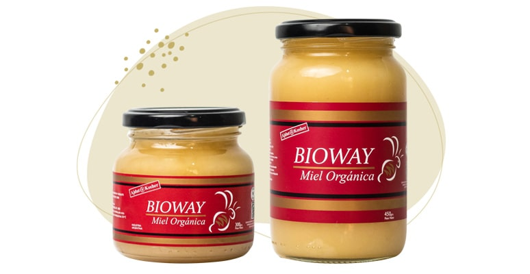 3 different packages of creamy solid organic all-flowers honey.
